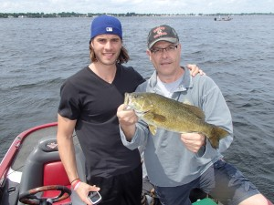 Pierre and son David with a drop shot smallie taken from 19 a foot depth